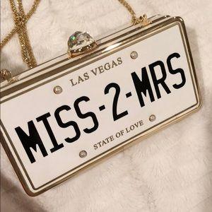 "Aldo ""Miss-2-Mrs"" License Plate Clutch"